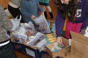 Putting together the gift bags complete with chocolates, candles and a children's bible.