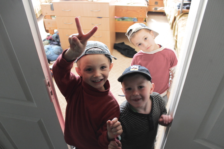 Three monkeys come out from their new bedroom ready to play.