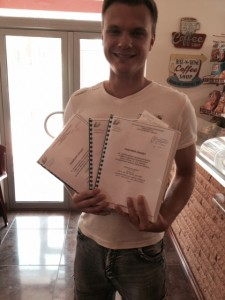 Dema holding our famous gas project documents - they've been to Gondor and back.