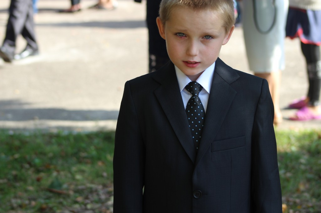 This is Ruslan.  He's a great kid who has been abandoned by his parents.  He is very polite and thankful.  He's sporting the new suit purchased by our supporters.