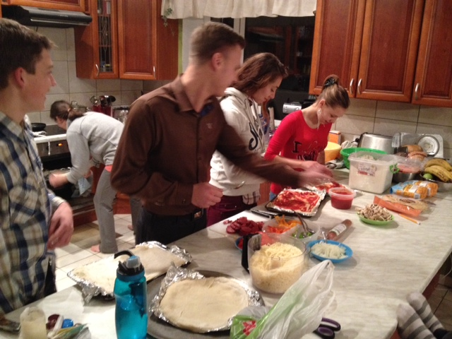 Cafe staff making pizza at our house during our little party this past weekend.