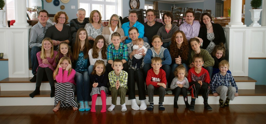 My parents, with their 4 kids, and all (but one) grandchildren.. heritage!
