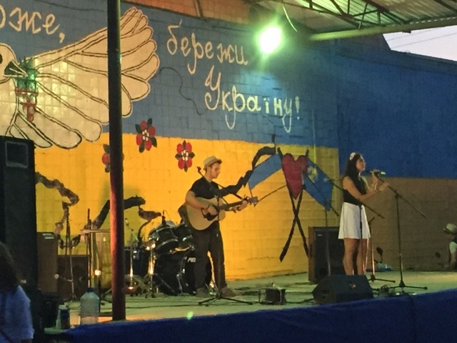 Last week our friends hosted a Live Concert festival for the town.  It was sponsored by Lighthouse Cafe and some other areas businesses.  Here is Sveta singing some Ukrainian tunes :)