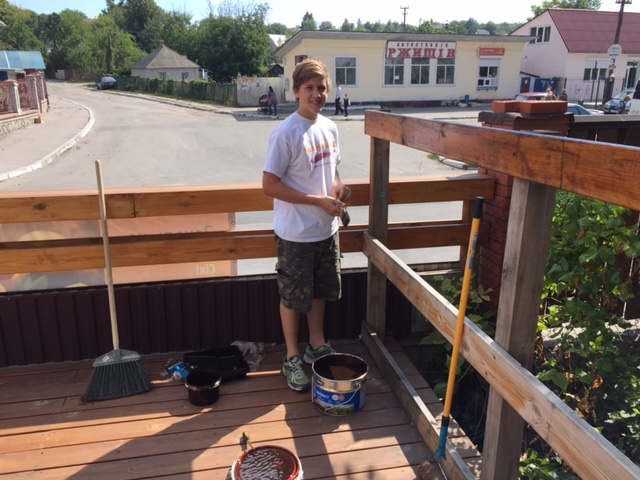 Brent has been a deck painting maniac this week - ours, then Neil's, and today the Cafe!