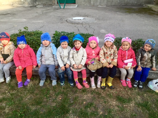 Abbey (yellow boots) playing with her classmates in her Kindergarten.