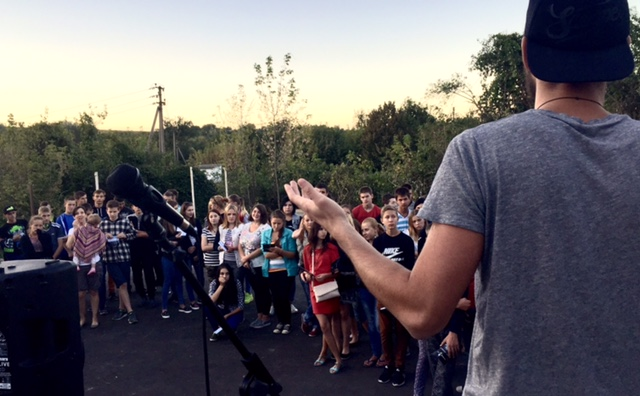Vova (new youth leader in area) sharing to the crowd about the love of God and ways for them to get connected this year.